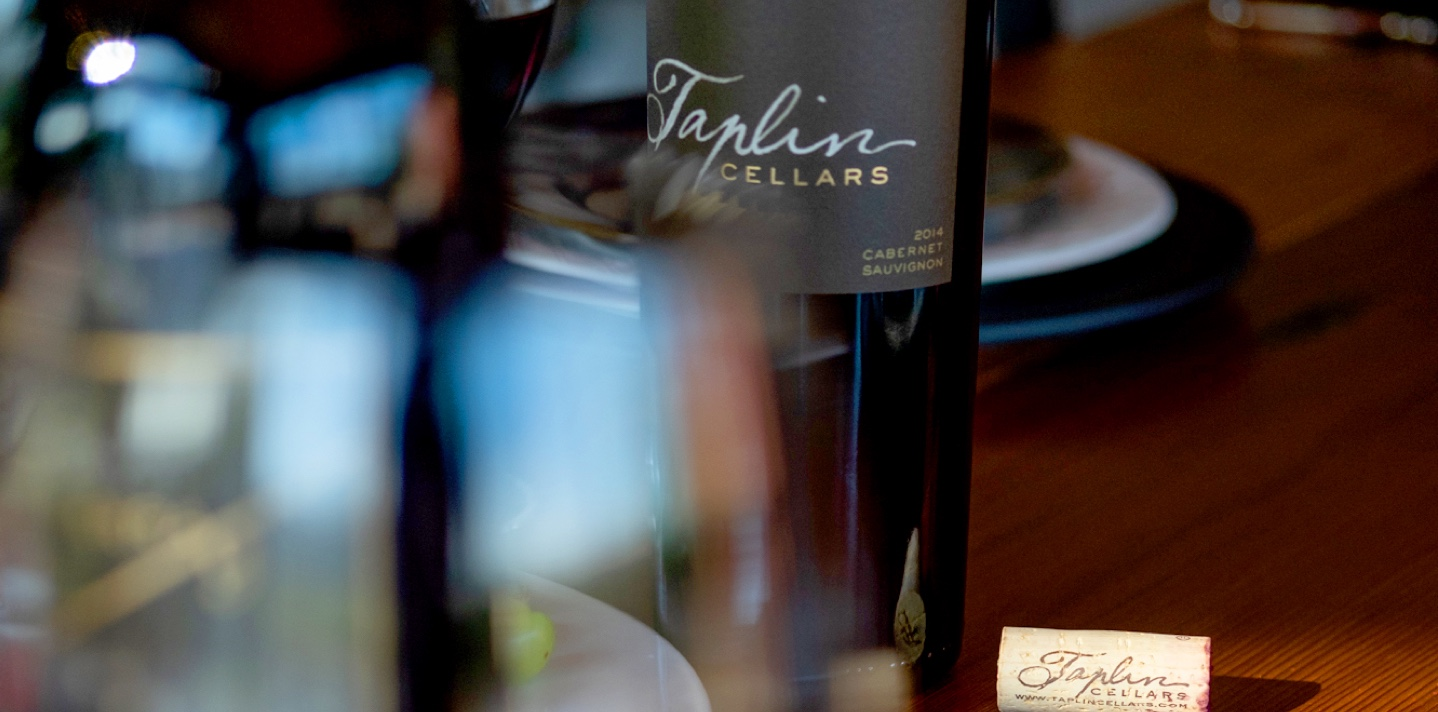 Taplin wines header background with wine bottles